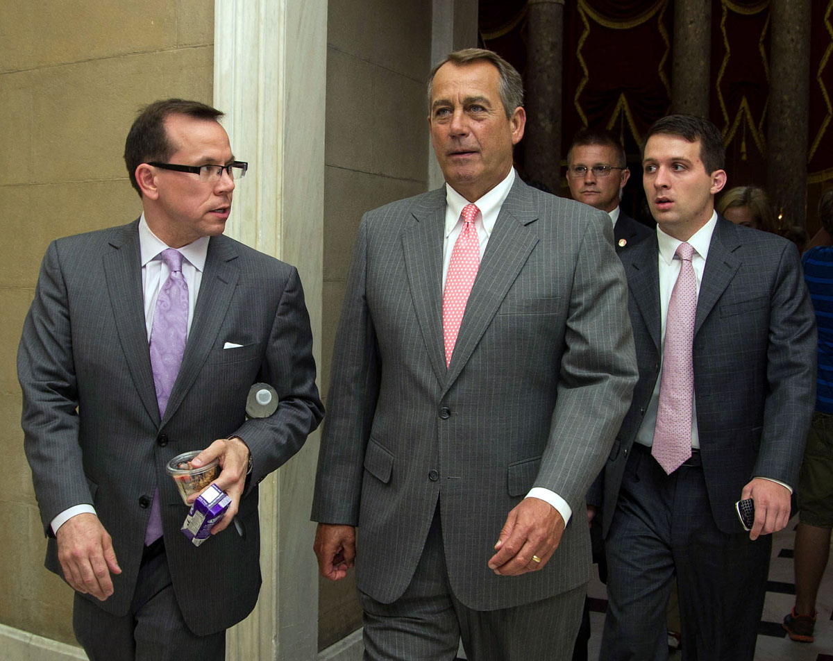 "June 28, 2012: US Speaker of the House John Boehner, Republican of Ohio, walks from the House chamber on June 28, 2012 on Capitol Hill in Washington, DC. Republican leaders set a July 11, 2012 vote in the House of Representatives to repeal US President Barack Obama's health care law, almost immediately after the Supreme Court upheld it. ""We don't have to accept 'Obamacare,'"" said Boehner in a message sent on his Twitter account. ""The House will continue to fight for a full repeal."" (Karen Bleier/AFP/Getty Images)"