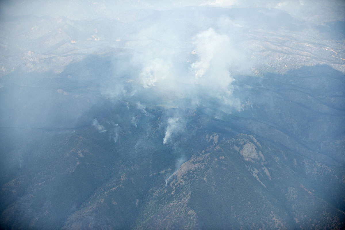 JUNE 29: A view taken from Air Force One shows smoke from wildfire near Interstate 25 on June 29, 2012 in Colorado. US President Barack Obama, who declared a major disaster in Colorado and offered federal assistance, is traveling to the Colorado Springs area to survey wildfire damage and the efforts to contain the natural disaster. (Brendan Smialowski/AFP/Getty Images)