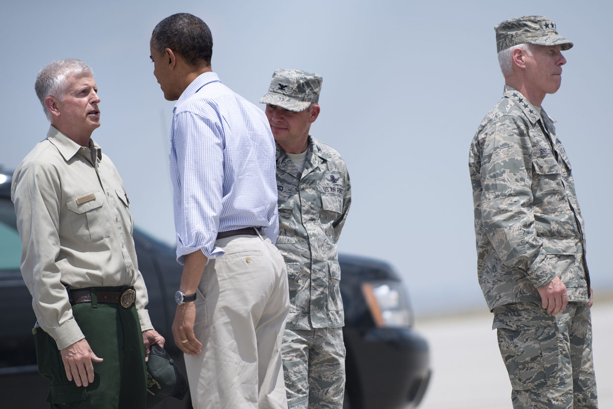 JUNE 29: US President Barack Obama speaks with US Forest Service Chief Tom Tidwell (L), as Air Force General Chris Crawford (2nd R) and General William Shelton stand by, after arriving at Colorado Springs Municipal Airport on June 29, 2012 in Colorado Springs, Colorado. Obama, who declared a major disaster in Colorado and offered federal assistance, is in the Colorado Springs area to survey wildfire damage and efforts to contain the natural disaster. (Brendan Smialowski/AFP/Getty Images)