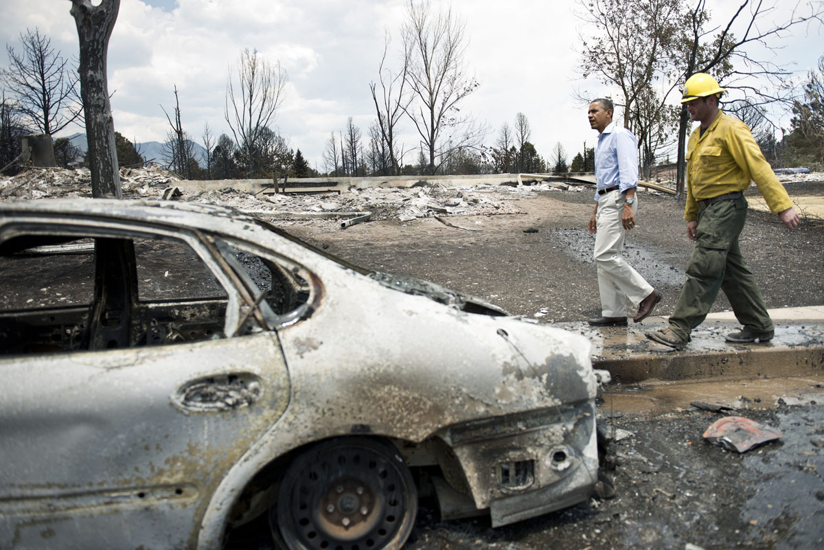 JUNE 29: US President Barack Obama tours the Mountain Shadow neighborhood which was burned by wildfires about 72 hours ago, on June 29, 2012 in Colorado Springs, Colorado. Obama, who declared a major disaster in Colorado and offered federal assistance, is in the Colorado Springs area to survey wildfire damage and efforts to contain the natural disaster. (Brendan Smialowski/AFP/GettyI mages)