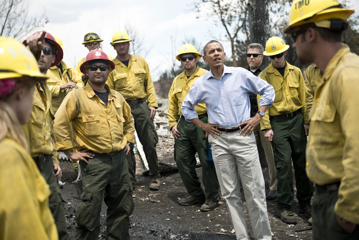 JUNE 29: US President Barack Obama pauses with fire fighters while touring the Mountain Shadow neighborhood which was burned by wildfires about 72 hours ago, on June 29, 2012 in Colorado Springs, Colorado. Obama, who declared a major disaster in Colorado and offered federal assistance, is in the Colorado Springs area to survey wildfire damage and efforts to contain the natural disaster. (Brendan Smialowski/AFP/GettyI mages)