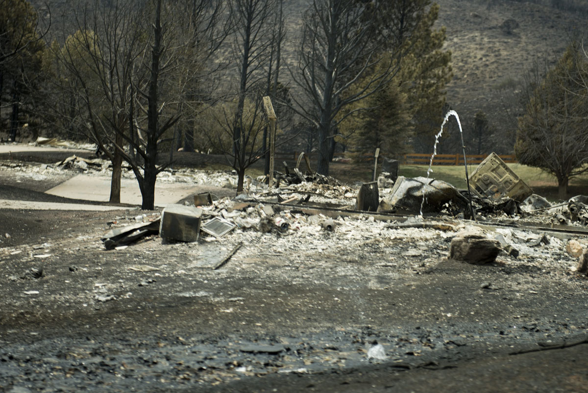JUNE 29: A view of wildfire damage in the Mountain Shadow neighborhood, which was burned by wildfires about 72 hours ago, is seen on June 29, 2012 in Colorado Springs, Colorado. US President Barack Obama, who declared a major disaster in Colorado and offered federal assistance, is in the Colorado Springs area to survey wildfire damage and efforts to contain the natural disaster.(Brendan Smialowski/AFP/Getty Images)