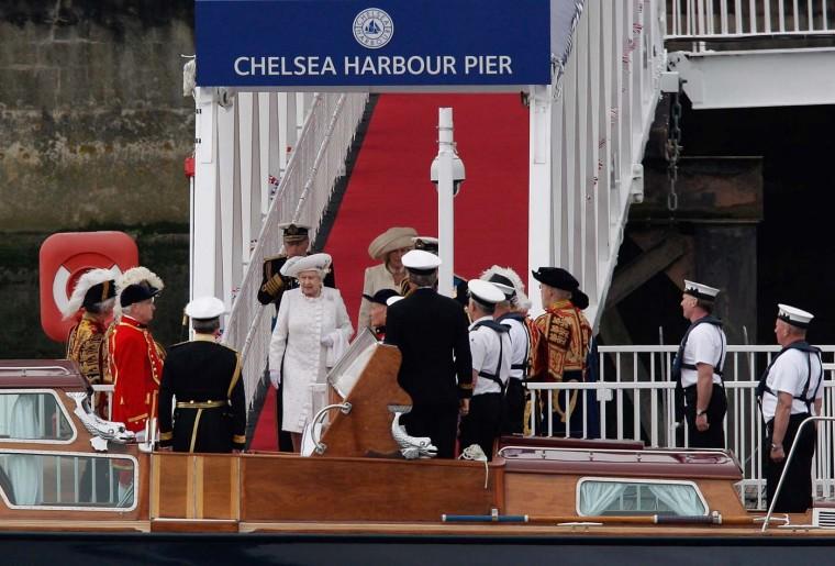 Queen Elizabeth II walks down the gangway to her launch on June 3, 2012 in London, England. (Harry Engels/Getty Images)