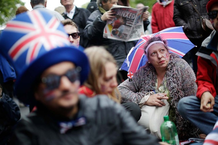 Revelers on Embankment take up vantage points hours in advance of the River Pageant on June 3, 2012 in London, England. (Matthew Lloyd/Getty Images)