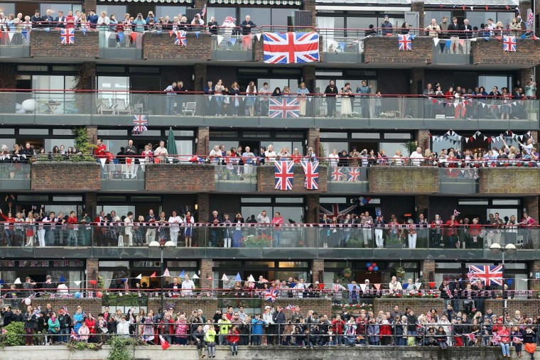Revelers line the route during the Diamond Jubilee River Pageant on June 3, 2012 in London, England. (Dan Kitwood/Getty Images)