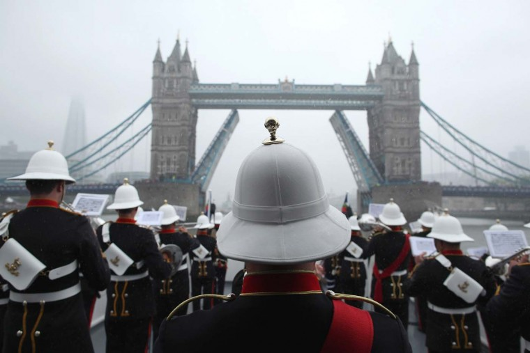 Members of Her Majesty's Royal Marine Band, Plymouth play in the pouring rain during the Diamond Jubilee River Pageant on June 3, 2012 in London, England. (Dan Kitwood/WPA Pool/Getty Images)