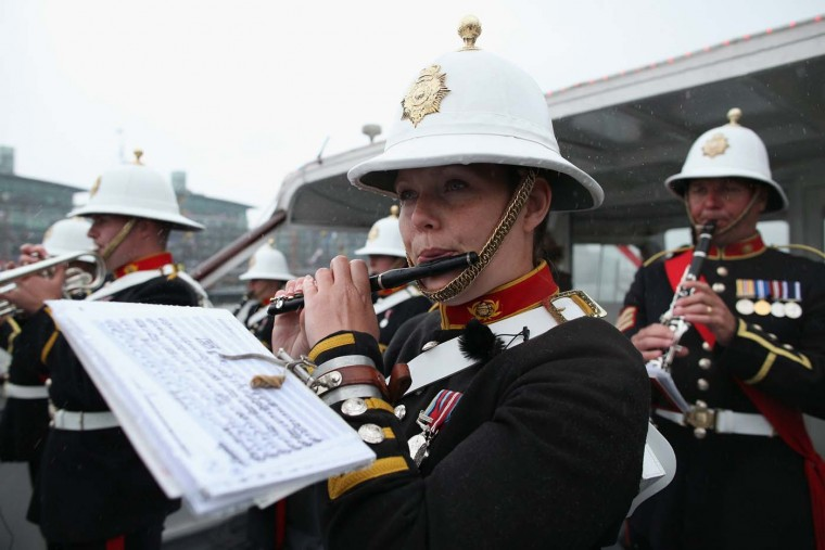 A member of Her Majesty's Royal Marine Band, Plymouth plays in the pouring rain during the Diamond Jubilee River Pageant on June 3, 2012 in London, England. (Dan Kitwood/WPA Pool /Getty Images)