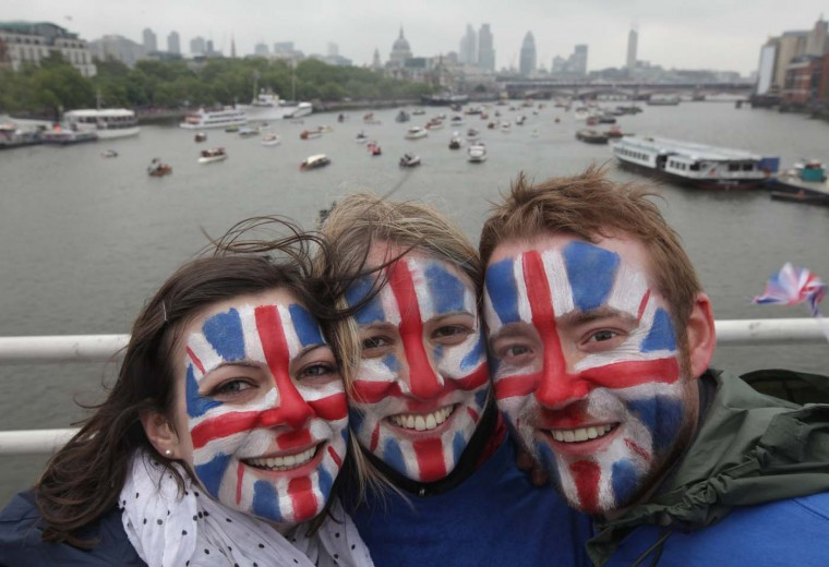 Spectators painted in the British flag stand on Waterloo Bridge over the Thames during the River Pageant of the Diamond Jubilee on June 3, 2012 in London, England. (Sean Gallup/Getty Images)