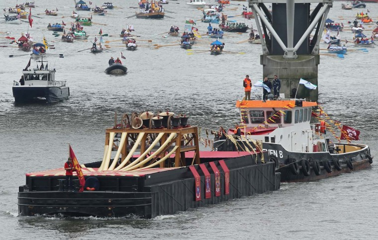 A tugboat pushing a barge bearing bells leads the River Pageant of the Diamond Jubilee on June 3, 2012 in London, England. (Sean Gallup/Getty Images)