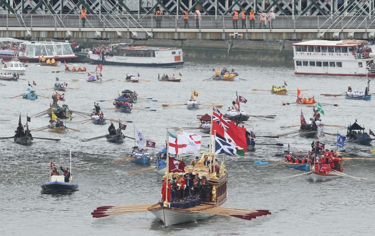 The boat Gloriana leads rowboats in the River Pageant of the Diamond Jubilee on June 3, 2012 in London, England. (Sean Gallup/Getty Images)