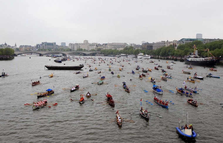 Rowing boats take part in the Diamond Jubilee River Thames pageant on June 3, 2012 in London, England. (Tom Shaw/Getty Images)