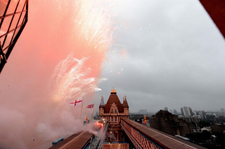 Fireworks are fired from Tower Bridge during the Diamond Jubilee River Pageant along the River Thames on June 3, 2012 in London, England. (Owen Humphreys/ WPA Pool/Getty Images)