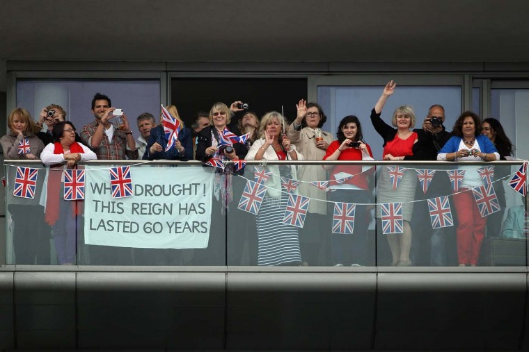 Revelers line the route during the Diamond Jubilee River Pageant on June 3, 2012 in London, England. (Dan Kitwood /WPA Pool/Getty Images)