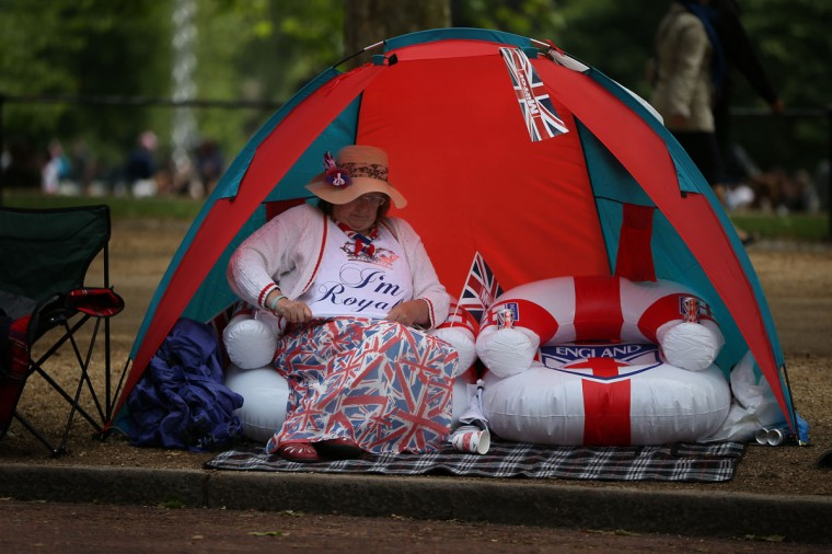 A woman sits in a tent in The Mall as she waits for The Diamond Jubilee Concert on June 4, 2012 in London, England. For only the second time in it's history, the UK celebrates the Diamond Jubilee of a monarch. Her Majesty Queen Elizabeth II celebrates the 60th anniversary of her ascension to the throne. (Peter Macdiarmid/Getty Images)