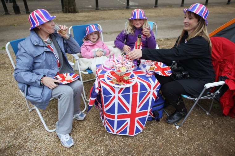 A family enjoy a picnic on The Mall as they wait for The Diamond Jubilee Concert on June 4, 2012 in London, England. Thousands of well-wishers from around the world have flocked to London to witness the spectacle of the weekend's celebrations. (Oli Scarff/Getty Images)