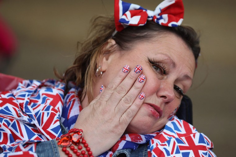 A woman with Union Flag painted nails sits on The Mall as she waits for The Diamond Jubilee Concert on June 4, 2012 in London, England. (Oli Scarff/Getty Images)