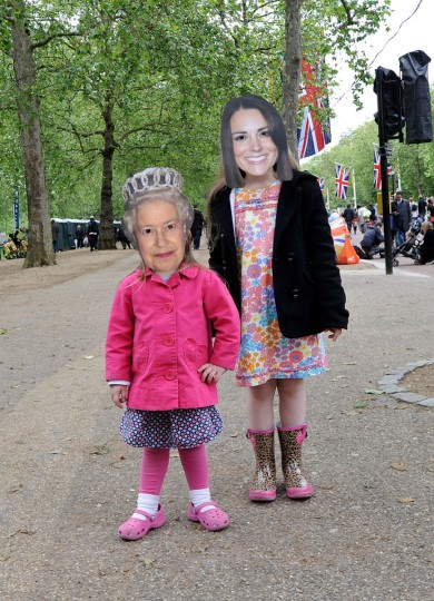 People pose wearing masks of Queen Elizabeth II and Catherine, Duchess of Cambridge in St James's Park prior to the Diamond Jubilee Buckingham Palace Concert on June 4, 2012 in London, England. (Gareth Cattermole/Getty Images)