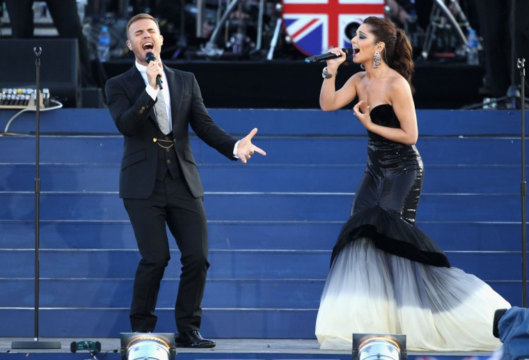 Singers Gary Barlow and Cheryl Cole performs on stage during the Diamond Jubilee concert at Buckingham Palace on June 4, 2012 in London, England. Her Majesty Queen Elizabeth II celebrates the 60th anniversary of her ascension to the throne. (Dan Kitwood/Getty Images)