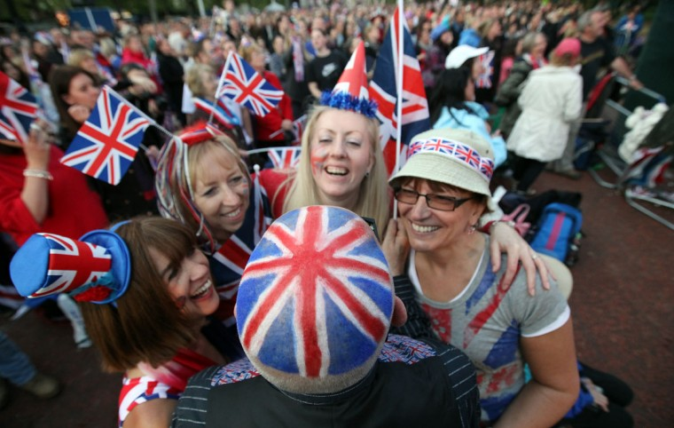 Diamond Jubilee revelers wear the Union Jack in the Mall during the entertainment at the Buckingham Palace Concert on June 4, 2012 in London, England. (Matt Cardy/Getty Images)
