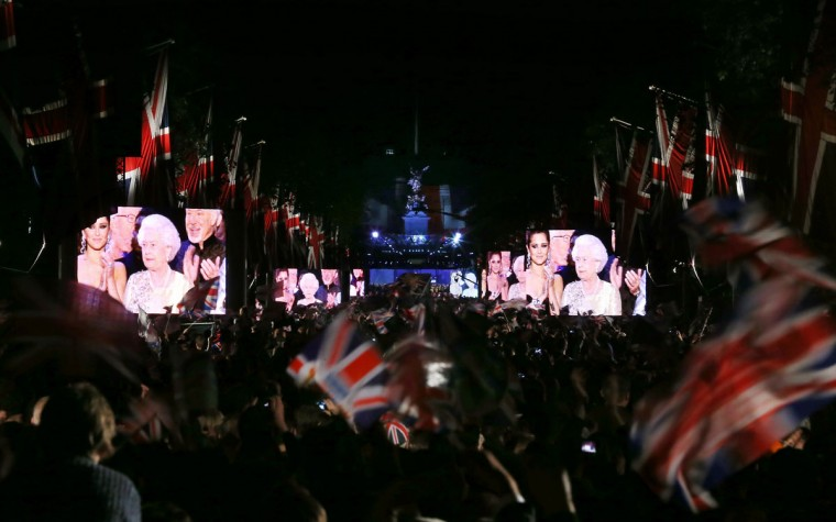 Queen Elizabeth II appears on giant video screens in The Mall at the end of The Diamond Jubilee Concert on June 4, 2012 in London, England. (Peter Macdiarmid/Getty Images)
