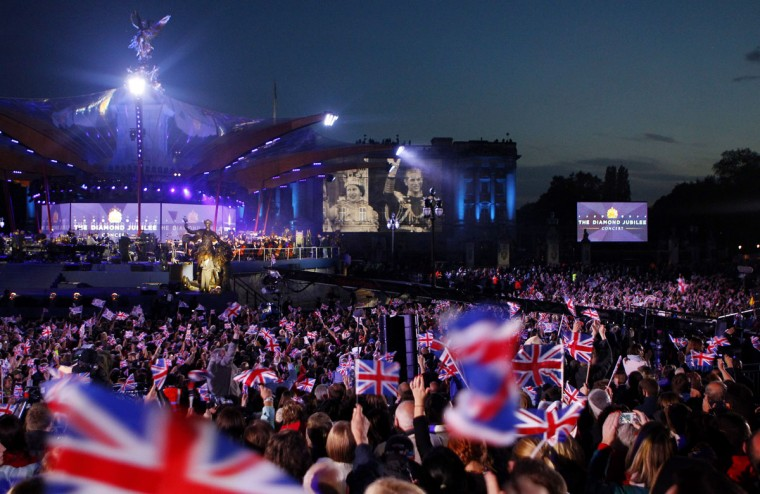 An image of Queen Elizabeth II and Prince Philip, Duke of Edinburgh is projected onto Buckingham Palace during the Diamond Jubilee, Buckingham Palace Concert on June 04, 2012 in London, England. (Dave Thompson - WPA Pool/Getty Images)