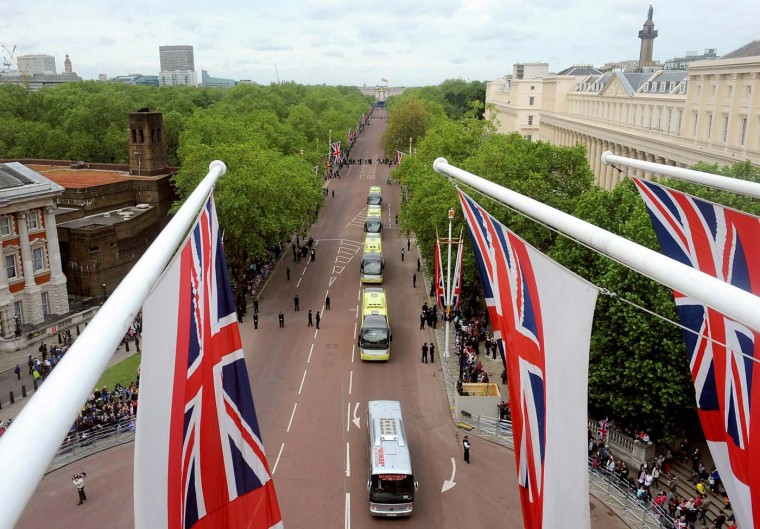Coaches transport guests from Buckingham Palace along the Mall for a Service of Thanksgiving at St. Paul's Cathedral on June 5, 2012 in London, England. (Anthony Devlin/WPA Pool/Getty Images)