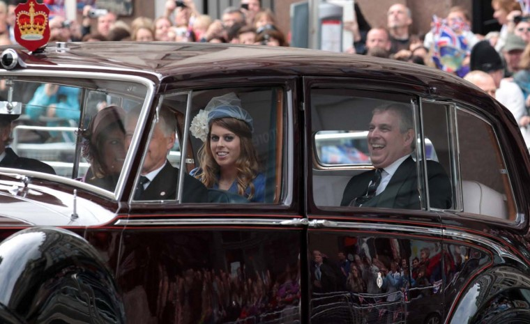 Prince Andrew, Duke of York laughs as he arrives with his daughters Princess Beatrice and Princess Eugenie at St. Paul's Cathedral for a Service of Thanksgiving on June 5, 2012 in London, England. (Matt Cardy/Getty Images)