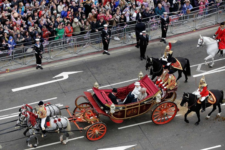 Queen Elizabeth II travels by carriage to Buckingham Palace with Camilla, Duchess of Cornwall and Prince Charles, Prince of Wales after a lunch at Westminster Hall on June 5, 2012 in London, England. (Matthew Lloyd/WPA Pool /Getty Images)