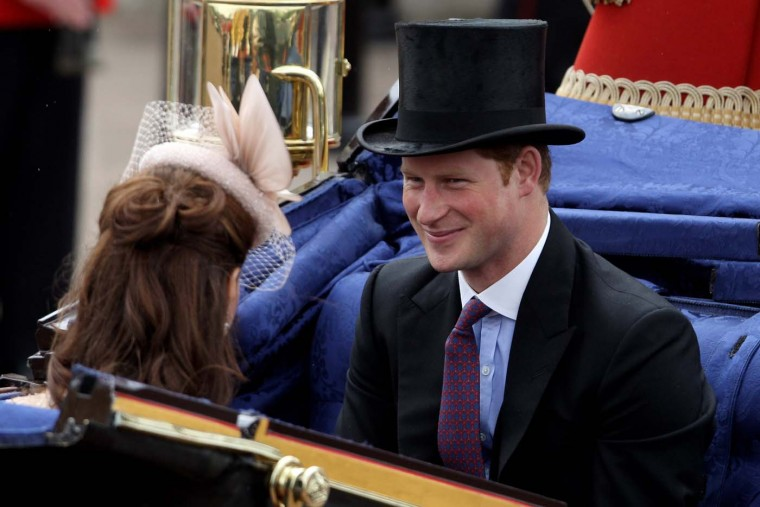 Prince Harry smiles during the Diamond Jubilee carriage procession after the service of thanksgiving at St.Paul's Cathedral on The Mall on June 5, 2012 in London, England. (Oli Scarff/Getty Images)