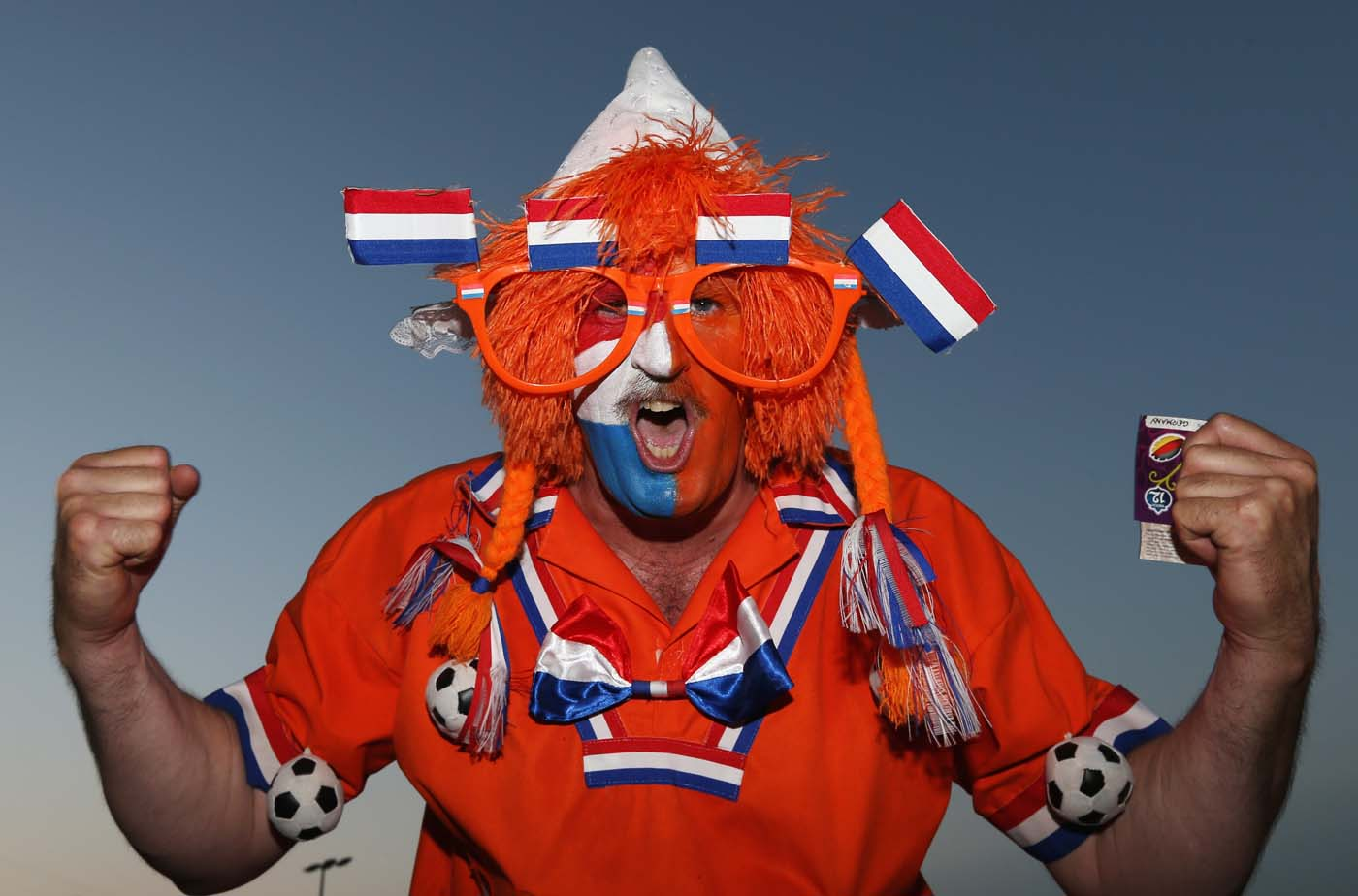 A Netherlands fan enjoys the atmosphere prior to the UEFA EURO 2012 group B match between Netherlands and Germany at Metalist Stadium on June 13, 2012 in Kharkov, Ukraine. (Julian Finney/Getty Images)