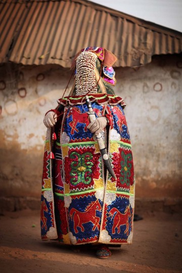 OUIDAH, BENIN - JANUARY 11: An 'Egungun' spirit stands during a Voodoo ceremony on January 11, 2012 in Ouidah, Benin. The Egungun are masqueraded dancers that represents the ancestral spirits of the Yoruba, a Nigerian ethnic group, and are believed to visit earth to possess and give guidance to the living. (Dan Kitwood/Getty Images)