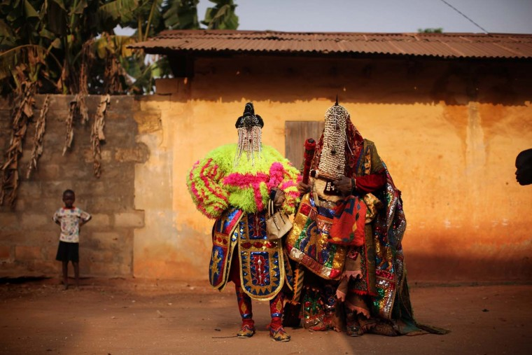 OUIDAH, BENIN - JANUARY 10: 'Egungun' spirits stand during a Voodoo ceremony on January 10, 2012 in Ouidah, Benin. Shrouded in mystery and often misunderstood, Voodoo was acknowledged as an official religion in Benin in 1989, and is increasing in popularity with around 17 percent of the population following it.(Dan Kitwood/Getty Images)