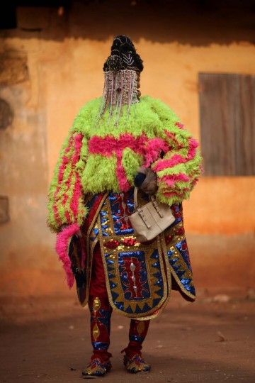 OUIDAH, BENIN - JANUARY 10: An 'Egungun' spirit stands during a Voodoo ceremony on January 10, 2012 in Ouidah, Benin. Shrouded in mystery and often misunderstood, Voodoo was acknowledged as an official religion in Benin in 1989, and is increasing in popularity with around 17 percent of the population following it. (Dan Kitwood/Getty Images)