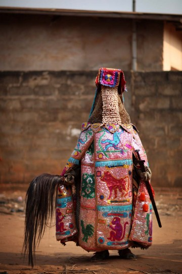 OUIDAH, BENIN - JANUARY 09: An 'Egungun' spirit stands during a Voodoo ceremony on January 09, 2012 in Ouidah, Benin. The Egungun are masqueraded dancers that represents the ancestral spirits of the Yoruba, a Nigerian ethnic group, and are believed to visit earth to possess and give guidance to the living. Ouidah is Benin's Voodoo heartland, and thought to be the spiritual birthplace of Voodoo or Vodun as it known in Benin. (Dan Kitwood/Getty Images)