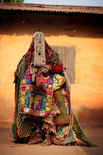 OUIDAH, BENIN - JANUARY 10: An 'Egungun' spirit stands during a Voodoo ceremony on January 10, 2012 in Ouidah, Benin. The Egungun are masqueraded dancers that represents the ancestral spirits of the Yoruba, a Nigerian ethnic group, and are believed to visit earth to possess and give guidance to the living. Ouidah is Benin's Voodoo heartland, and thought to be the spiritual birthplace of Voodoo or Vodun as it known in Benin. (Dan Kitwood/Getty Images)