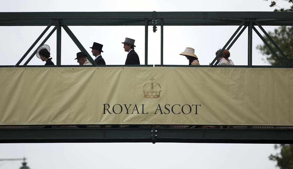 Racegoers walk over a footbridge to Royal Ascot on Ladies Day on in Ascot, England. Ladies Day is traditionally the fashion highlight of the five day race meeting. (Peter Macdiarmid/Getty Images)
