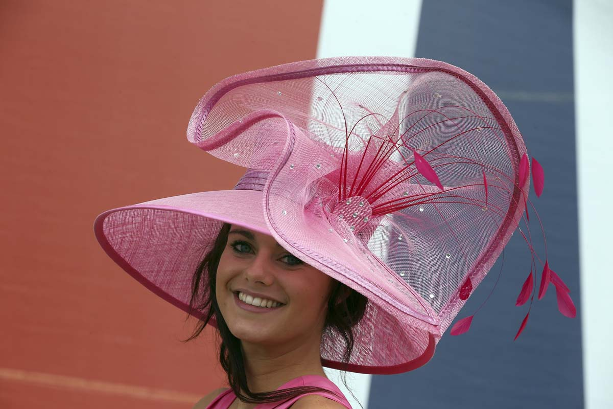 Racegoer Georgina Parham poses for photographers at Royal Ascot in Ascot, England. (Peter Macdiarmid/Getty Images)