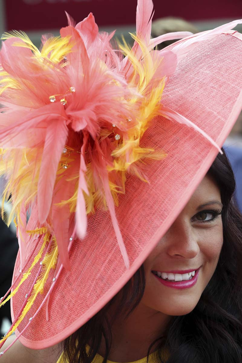 Racegoer Jamielea Cassidy poses for photographers at Royal Ascot in Ascot, England. Ladies Day is traditionally the fashion highlight of the five day race meeting. (Peter Macdiarmid/Getty Images)