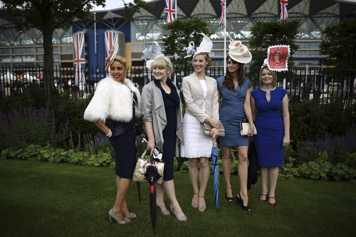 Racegoers pose for photographs at Royal Ascot on Ladies Day on in Ascot, England. Ladies Day is traditionally the fashion highlight of the five day race meeting. (Peter Macdiarmid/Getty Images)
