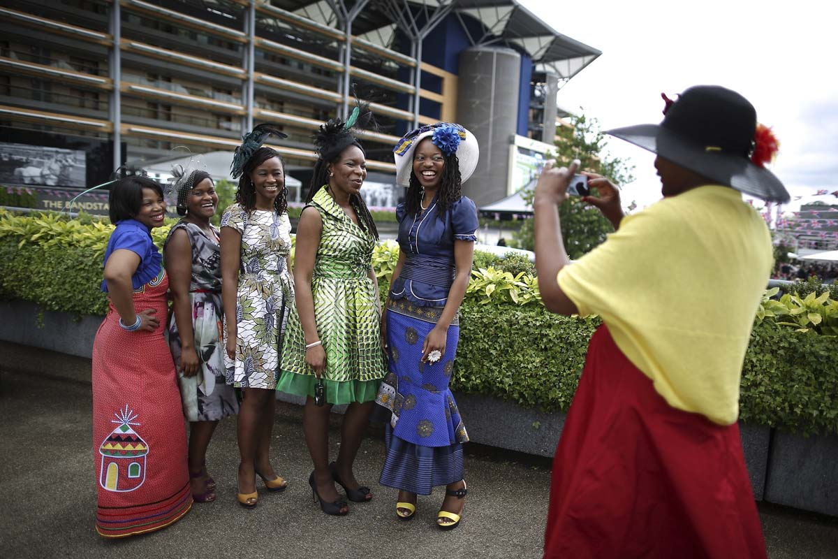 A visitor to Royal Ascot photographs her friends on Ladies Day on in Ascot, England. Ladies Day is traditionally the fashion highlight of the five day race meeting. (Peter Macdiarmid/Getty Images)