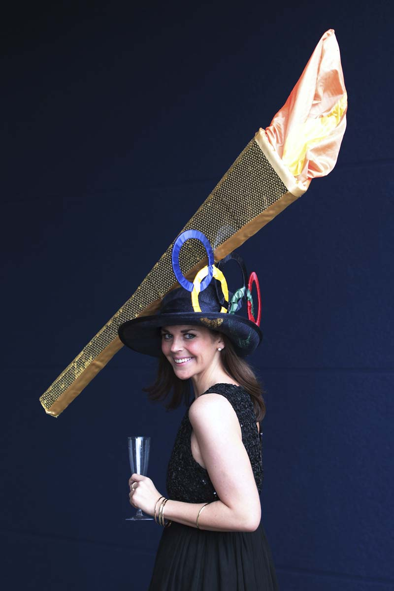Racegoer Laura Nelson wears an Olympic torch themed hat at Royal Ascot on Ladies Day in Ascot, England. (Peter Macdiarmid/Getty Images)