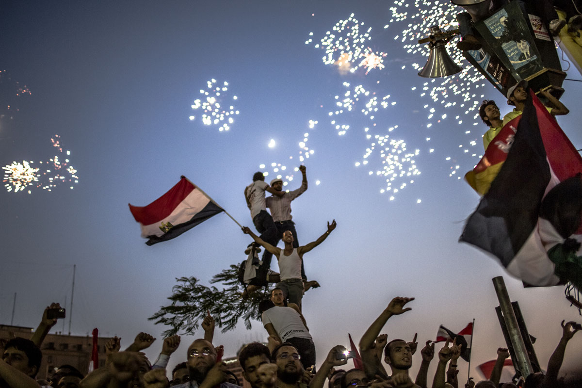 June 24, 2012 : Egyptians celebrate the election of their new president Mohamed Morsi in Tahrir Square in Cairo, Egypt. Official election results today confirmed that Mohamed Morsi is to be the next president of Egypt. Morsi received over 13 million or 51.7% of the votes, while his main rival, former Prime Minister Ahmed Shafiq, received 48.27 percent. (Daniel Berehulak/Getty Images)