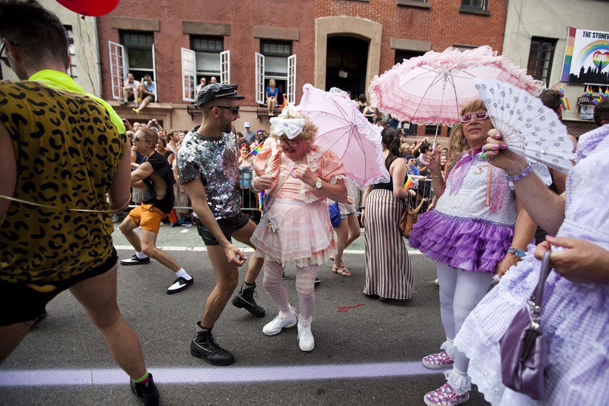 New York: Revelers dance in front of the Stonewall Inn during the Gay Pride March on June 24, 2012. The annual civil rights demonstration commemorates the Stonewall riots of 1969, which erupted after a police raid on a gay bar, the Stonewall Inn on Christopher Street. (Michael Nagle/Getty Images)