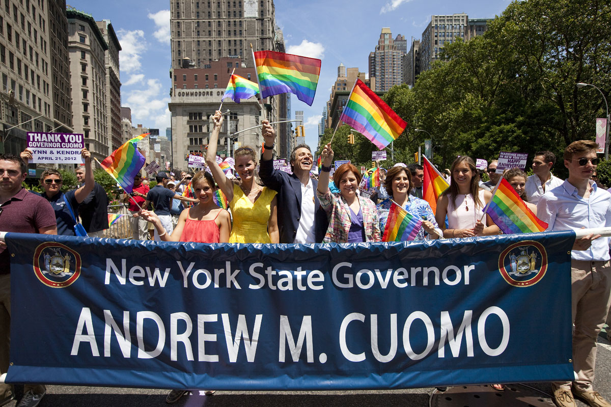 New York: Governor Andrew Cuomo (C-L) and NYC Council Speaker Christine Quinn (C-R) march in the Gay Pride March on June 24, 2012. The annual civil rights demonstration commemorates the Stonewall riots of 1969, which erupted after a police raid on a gay bar, the Stonewall Inn on Christopher Street. (Michael Nagle/Getty Images)