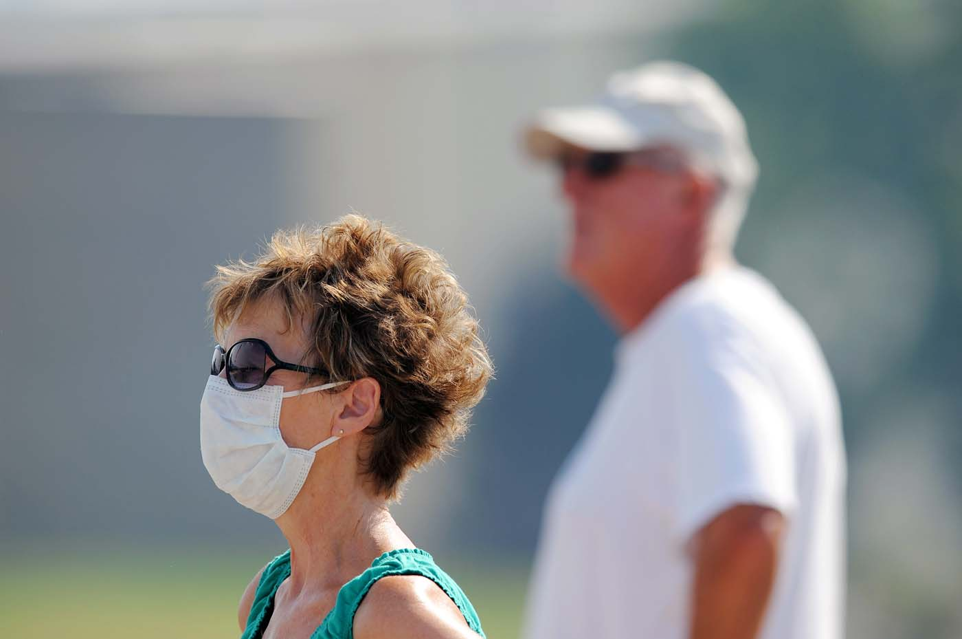 JUNE 27: Susan Custer (L) and her husband Gary Custer watch the Waldo Canyon fire on June 27, 2012 in Colorado Springs, Colorado. The fire burned several homes yesterday as it expanded to 15,000 acres, with over 32,000 people having been evacuated. (Chris Schneider/Getty Images)