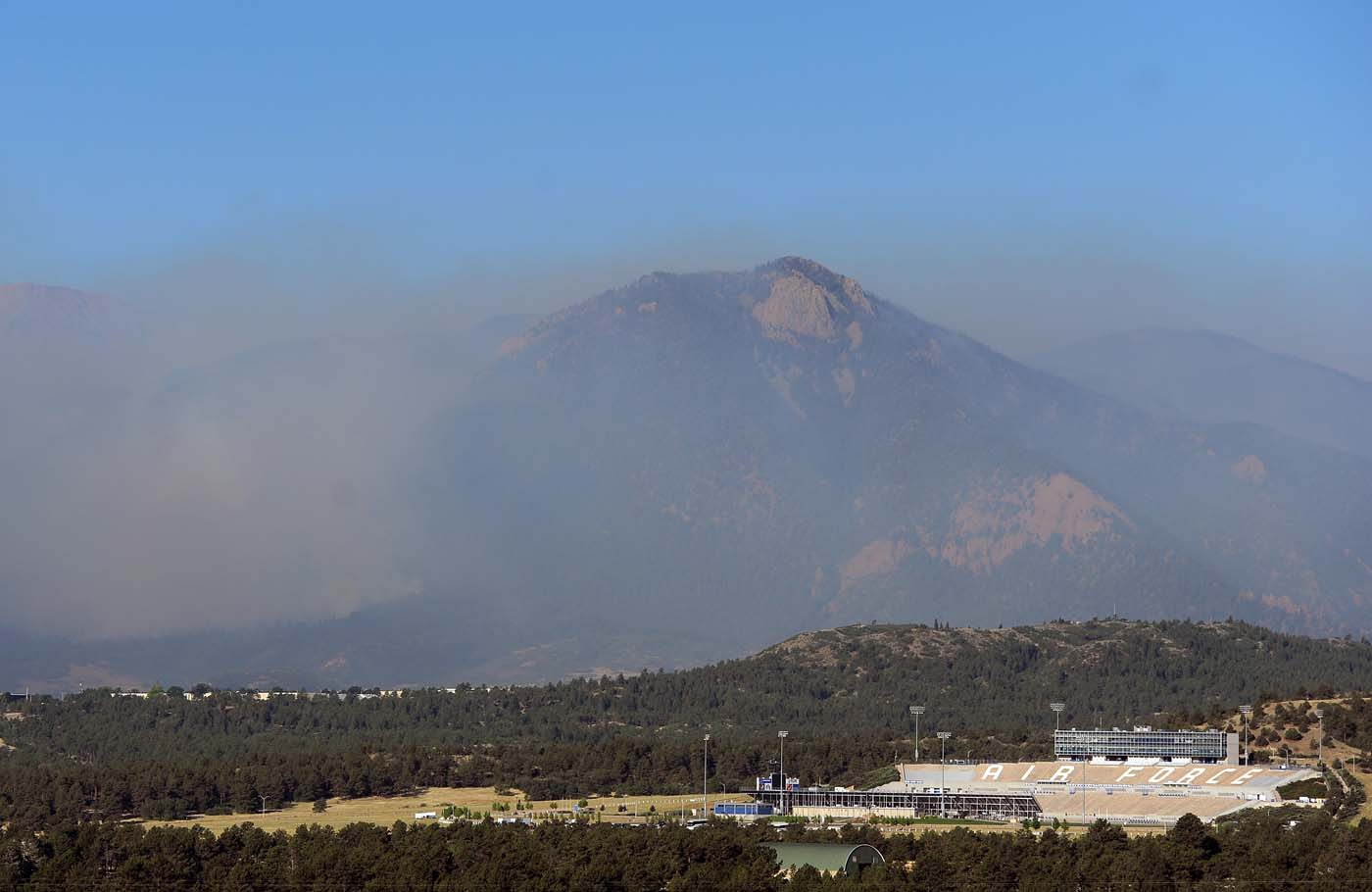 JUNE 27: Smoke from the Waldo Canyon fire lies behind the Air Force Academy stadium on June 27, 2012 in Colorado Springs, Colorado. (Chris Schneider/Getty Images)