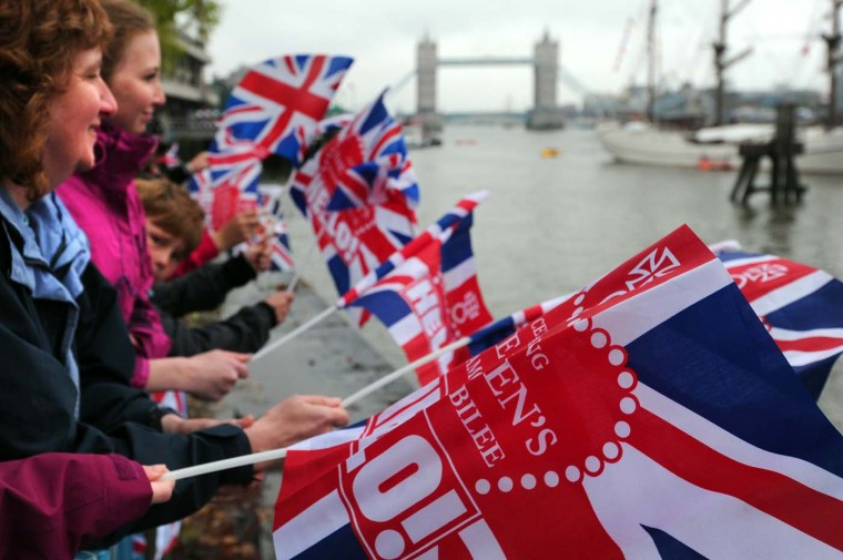Spectators wave Britain's Union flags during the Diamond Jubilee Pageant on the River Thames in London on June 3, 2012. (Carl Court/AFP/Getty Images)