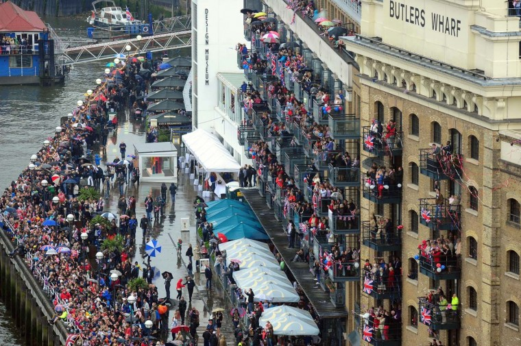 Crowds watch the Diamond Jubilee River Pageant from their balconies at Butlers Wharf next to Tower Bridge on June 3, 2012 in London. (Owen Humphreys/AFP/Getty Image)