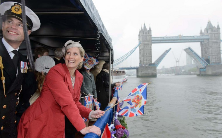 Prince Edward, Earl of Wessex (L) and Sophie, Countess of Wessex (2L) react to a musical performance aboard the boat 'Havengore' as it approaches Tower Bridge during the Thames Diamond Jubilee Pageant on the River Thames in central London on June 3, 2012. (Leon Neal/AFP/Getty Images)
