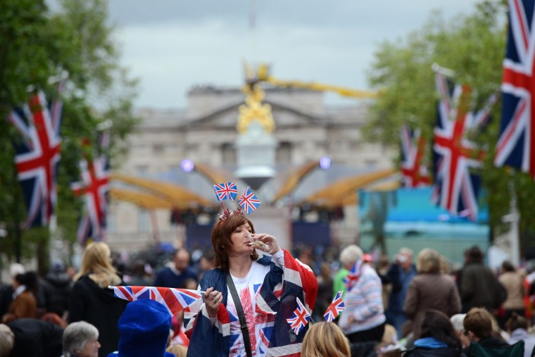 Royal supporters gather on the Mall outside Buckingham Palace (Background) in London, on June 4, 2012, in preparation for the Queen's Jubilee concert. (Adrian Dennis/AFP/Getty Images)